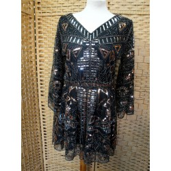 With Angel Sequins sleeve...